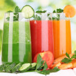 Fresh vegetable juices on wooden table, on green background — Stock Photo #29531595