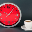 Cup coffee and clock on gray background — Stock Photo #29533127