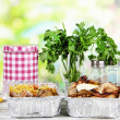 Food in boxes of foil on wooden table on nature background — Stock Photo #29533569
