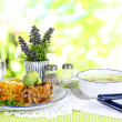 Soup and rice with meat in plates on napkin on tablecloth on nature background — Foto de Stock