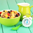 Stock Photo: Oatmeal with fruits on table close-up