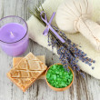 Still life with lavender candle, soap, massage balls, soap and fresh lavender, on wooden background — Stock Photo