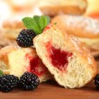 Stock Photo: Tasty donuts with berries on wooden table