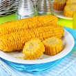 Flavored boiled corn on plate on wooden table close-up — Stock Photo #29534383