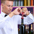 Bartender opens bottle of wine — Stock Photo #29534519
