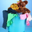 Laundry basket on blue background — Stock Photo #29534569