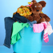 Laundry basket on blue background — Stock Photo