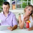 Stock Photo: Young couple taking with tablet in restaurant