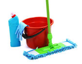 Mop, plastic bucket and rubber gloves, isolated on white — Stock Photo