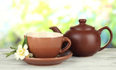 Cup of tea with jasmine, on bright background — Stock Photo