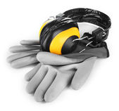 Protective gloves and headphones isolated on white — Stock Photo