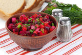 Beet salad in bowl on table close-up — Stock Photo