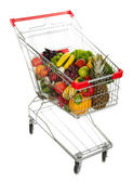 Different fruits and vegetables in trolley isolated on white — Stock Photo