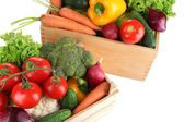 Fresh vegetables in wooden boxes on white background — Stock Photo