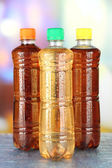 Assortment of bottles with tasty drinks, on bright background — Stock Photo