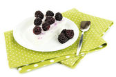 Cheesecake with fresh berries on white plate isolated on white — Stock Photo