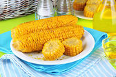 Flavored boiled corn on plate on wooden table close-up — Stok fotoğraf