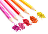 Colour pencils with sharpening shavings isolated on white — Stock Photo