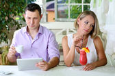 Young couple taking with tablet in restaurant — Stock Photo