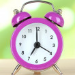 Alarm clock on table on light background — Stock Photo #29577703