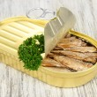 Open tin can with sardines, on wooden background — Stock Photo #29578163