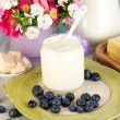 Stock Photo: Fresh dairy products with blueberry on wooden table close-up