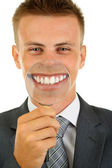 Businessman with magnifying glass zooming on his smile — Stock Photo