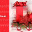 Christmas gift and red Christmas balls in white fur — Stock Photo