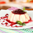 PannCottwith raspberry sauce, on bright background — Stock Photo #29620403
