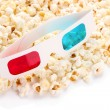 Stock Photo: Popcorn and 3D glasses, isolated on white