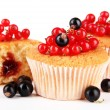 Tasty muffins with berries isolated on white — Stock Photo #29621019