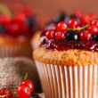 Tasty muffins with berries on wooden table — Stock Photo #29621027
