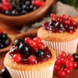 Tasty muffins with berries on wooden table — Stock Photo #29621039