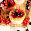 Tasty muffins with berries on white wooden table — Stock Photo #29621041
