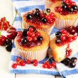 Tasty muffins with berries on white wooden table — Stock Photo #29621047