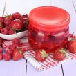Stock Photo: Home made berry jam on wooden table