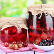 Home made berry jam on wooden table on bright background — Stock Photo #29621159