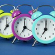 Colorful alarm clock on blue background — Stock Photo #29621417