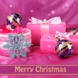 Beautiful gifts, Christmas balls and snowflake on a pink background — Stock Photo #29626361