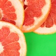 Grapefruit slices frame on color background — Stock Photo