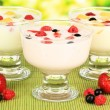 Delicious yogurt with fruit on table on bright background — Stock Photo #29626773