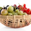 Different summer berries in basket isolated on white — Stock Photo