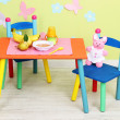 tasty baby fruit puree and baby bottle on table in room — Stock Photo #29626949