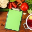 Fresh vegetables and spices and paper for notes, on wooden background — Стоковая фотография