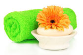 Rolled green towel, soap bar and beautiful flower isolated on white — Stock Photo