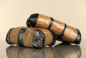 Packages of narcotics on gray background — Stock Photo