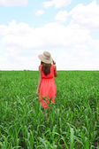 Portrait of beautiful young woman in the field — Stock Photo