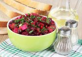 Beet salad in bowl on table close-up — Stok fotoğraf