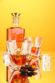 Bottle and two glasses of scotch whiskey, on color background — 图库照片