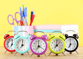 Colorful alarm clock on table on yellow background — Foto de Stock